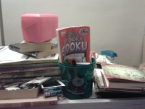 A small example of my clutter . . . the table next to my seat on the couch