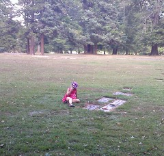 My daughter talking to her mom-mom Janice on our last visit to the cemetary, 9/4/10